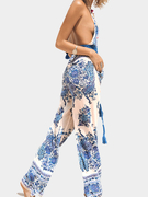 Bohemian Peacock Print Plunging Neck Jumpsuit with Open Back