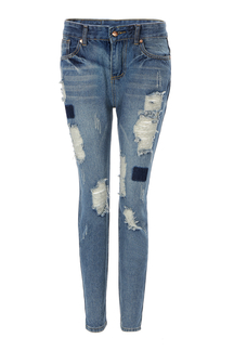 Ripped Jeans In Vintage Wash